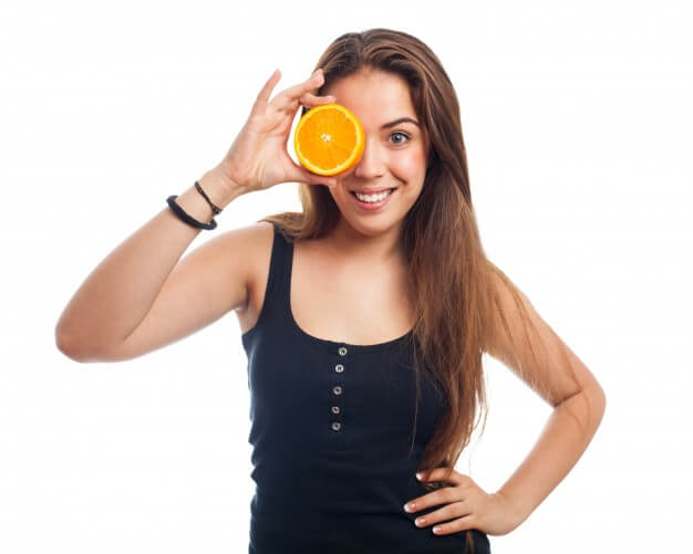 girl-covering-her-eye-with-a-orange_1149-711